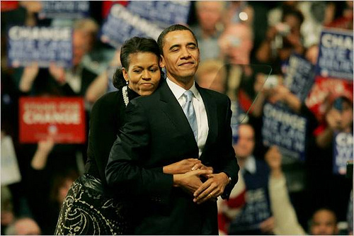 Barack and Michelle Obama With a little Victory Hug