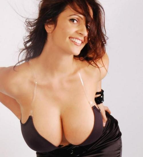 Denise Milani Smiles and Displays her Momentous Cleavage.