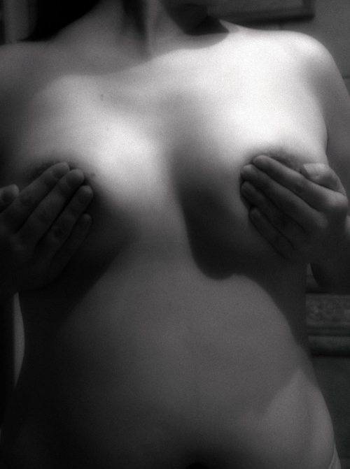 B&W Picture of a Woman Covering Her Nipples. Nozzles. Whatever. Nice Pic.