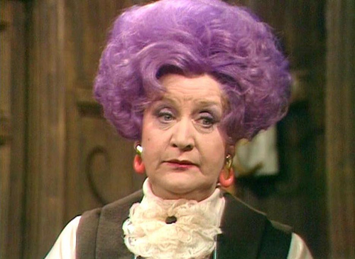 Molle Sugden as a Purple Haired Mrs. Slocombe