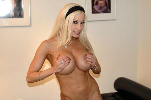 Gina Lynn Covering Her Boobs with her Hands.